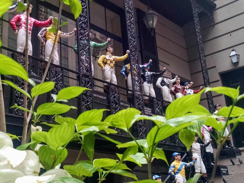Lawn jockeys on the balcony above the entrance to 21 Club