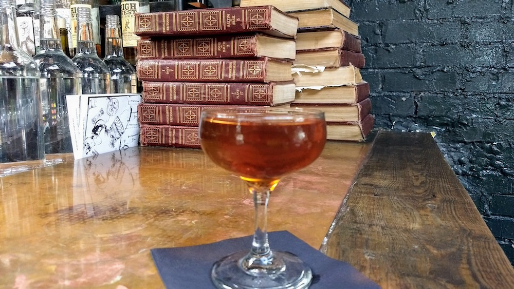 Cocktail and books and The Garret