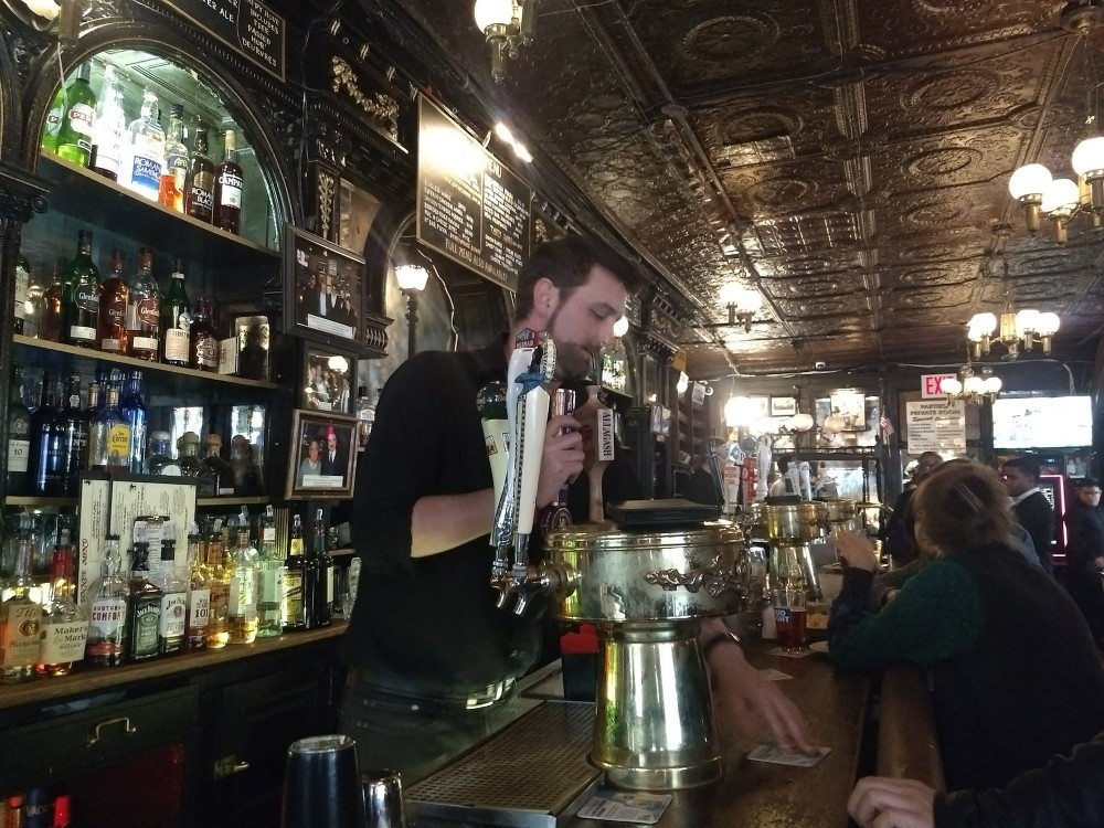 Busy bartender at Pete's Tavern