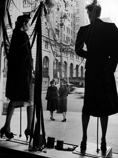 Elegantly dressed Women on Corner of Fifth Avenue and 58th in front of Window of Bergdorf Goodman By Alfred Eisenstaedt from the historical archives of LIFE Magazine.