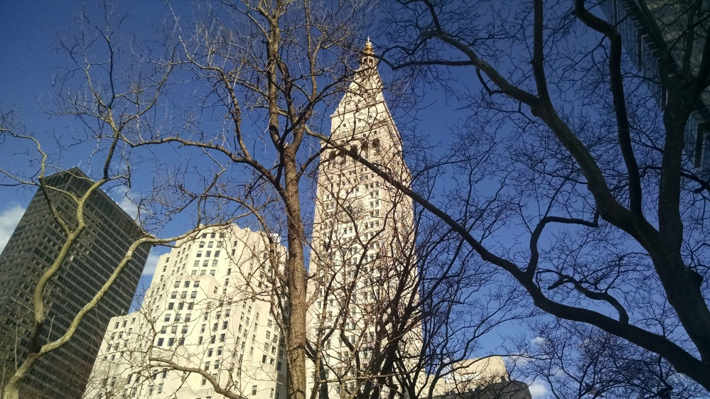The Metropolitan Life Insurance Company Tower (right) and North Building (left) as seen from the Madison Square Park