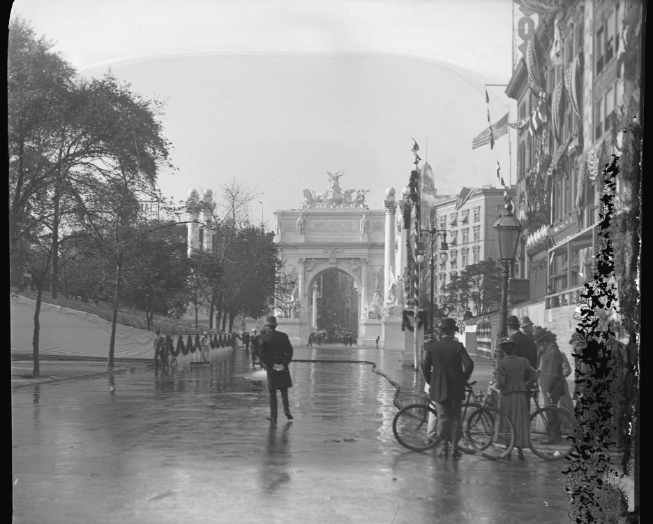 Cyclists looking at the Dewey Arch, Madison Square, New York City, September 30, 1899.