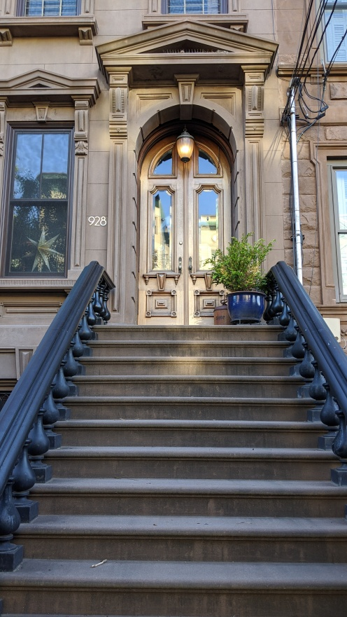 Brownstone entrance - a stoop and a door
